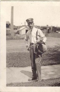 Jack Wallis serving as postman in Ann Arbor, ca. 1915.