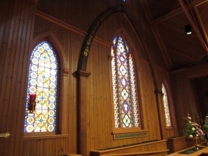 Both the painted arch and the stained glass windows were salvaged and given a place of honor in the new Episcopal Church.
