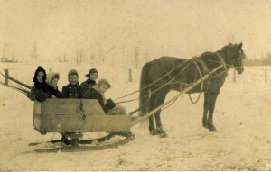 Billy the horse; driving is Jane Shilson, riding with Mabel Wilhelm, Olive Lackey, Claribel Wilhelm and unknown woman.
