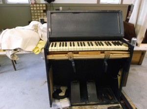 Not ready for inspection! Military chaplain's portable reed organ, World War II-era; Currently undergoing restoration in the Workshop.