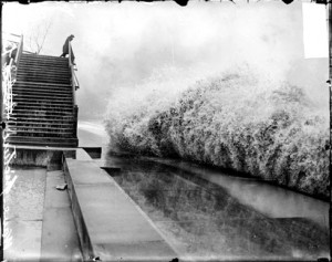 Wave breaking on the shore of Lake Michigan by Lincoln Park while a man watches from High Bridge Chicago Daily News, Inc., photographer. Published 1913 Nov. 10. Photo courtesy of Library of Congress, American Memory project.