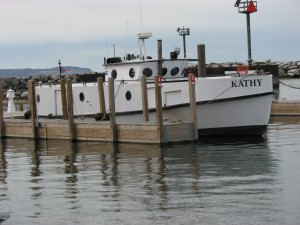 "Standard modern fishing tug, ""Kathy,"" docked at Leland Harbor, May 2015. Image courtesy of the author."
