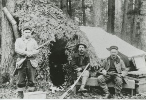 Left, James Samuel Brady, son of James Gray Brady; Right, William Wallace Smith, James Samuel's father-in-law. Center, Uncle Willie,  at their hunting camp east of Kalkaska, ca. 1900?