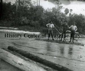 Men at Betsie River, working with peavys to ensure logs are driven downriver. Image courtesy of the Bensley Collection, History Center of Traverse City.