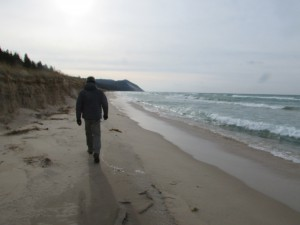 A beautiful day for a bird count; Brian Allen on the shores of Lake Michigan in Benzie County. Image courtesy of the author.