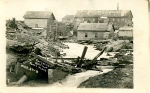 """Road bridge north of power plant"", Mayfield Dam Washout, 24 March 1913. Image courtesy of Tom Olds. Olds' Historical Postcard Collection has been digitized and is available at localhistory.tadl.org"