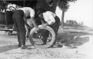 An example of what it took to change out a tire, when poor Robert's were punctured. Henry J. WItkop and Dave Youker changing the tire on Witkop's Napolean car, ca. 1920. Image courtesy of Bean Collection, 850.051007.87.