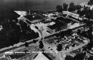 Cherry Growers Canning Company, aerial view from 1947, shows wharf and railroad spur. TADL Historical Society Collection, 3303.
